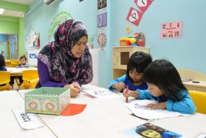 Iyad Perdaus teacher and children learning in a class